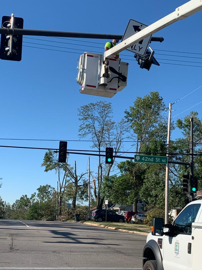 Picture of Public Works Crew Member Fixing Sign